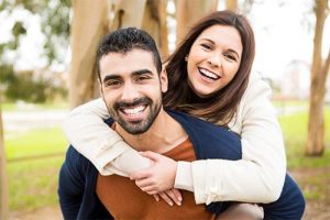 Happy Couple Smiling - New Year's Resolutions For A Healthy Smile